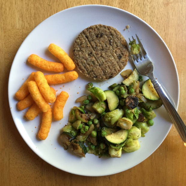 Veggie burger and brussels sprouts