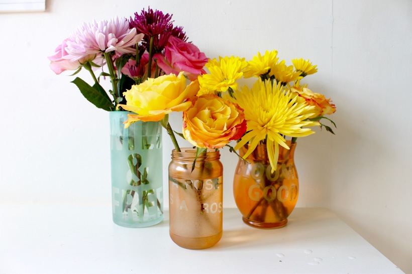Colorful etched vases with flower puns and sayings